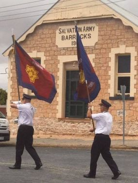 Melbourne Staff Band walk past the oriignal Salvation army barracks on the Copper Coast